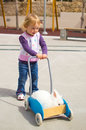 Cute girl and rabbit beautiful small pushing her pet on the trolley Stock Photo