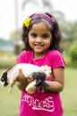 Cute girl with a rabbit holding baby rabbbit Royalty Free Stock Photo
