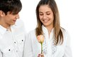 Cute girl receiving a rose from boyfriend. Stock Photos