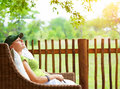 Cute girl resting on veranda young traveler woman sleeping backyard in sanatorium relaxation outdoors luxury resort pleasure Royalty Free Stock Photos
