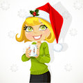 Cute girl in Santa hat hold cup of hot drink Stock Images