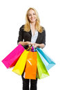 Cute girl with shopping bags isolated on white background Royalty Free Stock Photos
