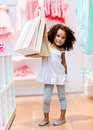Cute girl with shopping bags little at the store Royalty Free Stock Photography