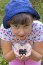 Cute girl showing blackberries in her hands Stock Image
