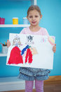 Cute girl showing her drawing Royalty Free Stock Photo