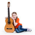 Cute girl sitting with acoustic guitar bright emotions isolated on white background Royalty Free Stock Image