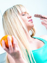 Cute girl smelling chocolate bar of chocolate Royalty Free Stock Photography