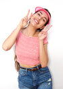 Cute girl smiling with peace hand sign Royalty Free Stock Photo