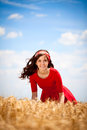 Cute girl in smiling woman in white dress in field Royalty Free Stock Photo