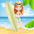 Cute girl with a surfboard and glass of juice on a sunny beach Stock Image