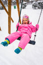 Cute girl in swing winter Stock Photos