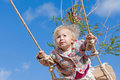 Cute girl swinging Royalty Free Stock Photos