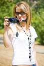 Cute girl taking photos Royalty Free Stock Photo