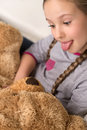 Cute girl with toy bear cheerful little holding and grimacing Stock Photo