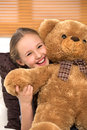 Cute girl with toy bear cheerful little hugging and looking at camera Royalty Free Stock Photo