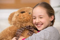 Cute girl with toy bear cheerful little hugging and smiling Royalty Free Stock Photography