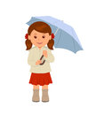 Cute girl under an umbrella.  character of a young woman in a red skirt and a beige jacket under an umbrella. Royalty Free Stock Photo