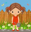Cute girl with a watering can. Gardening
