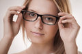 Cute girl wearing glasses Royalty Free Stock Images