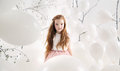Cute girl among white balloons Royalty Free Stock Photo