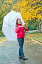 Cute girl with white umbrella walking Royalty Free Stock Photography