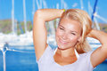 Cute girl in yacht harbor closeup portrait of attractive blond female on background happy smiling enjoying summer adventure Stock Images