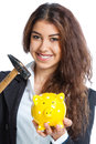 Cute girl with yellow piggy bank and hammer on white background Stock Photos