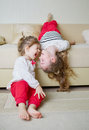 Cute girls on the couch upside down Royalty Free Stock Photo