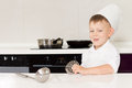 Cute grinning little boy in a chefs hat and apron Royalty Free Stock Photo