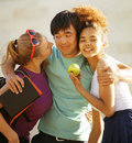 Cute group of teenages at the building of university with books huggings diversity nations Stock Photo