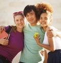 Cute group of teenages at the building of university with books huggings diversity nations Royalty Free Stock Image