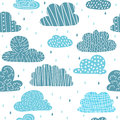 Cute hand drawn seamless pattern with clouds. Funny background