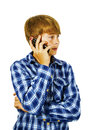 Cute handsome young boy speaking a mobile phone Royalty Free Stock Photography