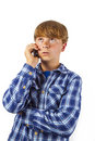 Cute handsome young boy speaking a mobile phone Royalty Free Stock Images