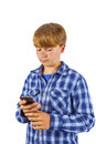 Cute handsome young boy speaking using his mobile phone Stock Photo