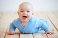 Cute happy baby boy crawling on the floor Royalty Free Stock Photo