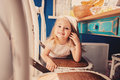 Cute happy baby girl having fun on the kitchen Royalty Free Stock Photo