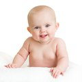 Cute happy baby kid lying isolated on white Royalty Free Stock Photo
