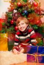 Cute happy boy waiting for presents opening Royalty Free Stock Image