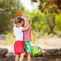 Cute happy children playing in spring filed two little girls with watermelon outdoors Royalty Free Stock Image