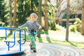 Cute happy kid. Boy playing on playground in a park. Royalty Free Stock Photo