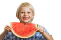 Cute happy laughing boy eating water melon a holding a big juicy slice of watermelon isolated on white Royalty Free Stock Photography