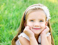 Cute happy little girl on the meadow Royalty Free Stock Photo