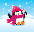 Cute and happy penguin cartoon illustration of a character sitting in the snow holding a candy cane wearing a striped scarf Royalty Free Stock Photo