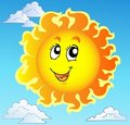 Cute happy Sun on blue sky Royalty Free Stock Images