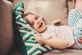 Cute happy toddler girl having fun at home