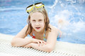 Cute happy young girl child swimming relaxing on pool wearing goggles Royalty Free Stock Images