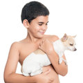 Cute hispanic boy carrying a small chihuahua dog Royalty Free Stock Photo