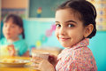 Cute hispanic girl drinking milk at school Royalty Free Stock Photo