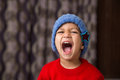 Cute Indian Kid striking a pose in winter wear with a big laugh Royalty Free Stock Photo